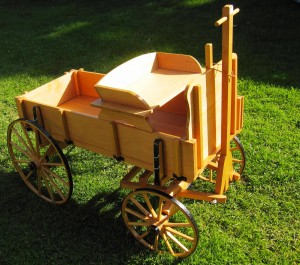 Hand-made wagon (goat cart) is hard to let go